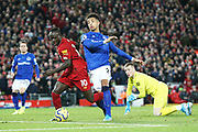 Liverpool forward Sadio Mane (10) is challenged by Everton defender Mason Holgate (2)in the box  during the Premier League match between Liverpool and Everton at Anfield, Liverpool, England on 4 December 2019.