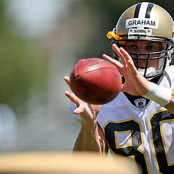 July 31, 2011; Metairie, LA, USA; New Orleans Saints tight end Jimmy Graham (80) catches passes at the end of training camp practice at the New Orleans Saints practice facility. Mandatory Credit: Derick E. Hingle