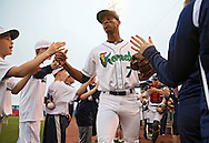 Kernels Center Fielder Byron Buxton (7) takes the field before the start of a game between the Cedar Rapids Kernels and the Quad Cities River Bandits at Veterans Memorial Stadium in Cedar Rapids, Iowa on June 5, 2013.