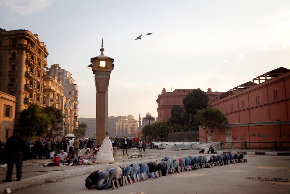 Opposition supporters pray in Tahrir Square in Cairo, Egypt, on Tuesday, Feb. 8, 2011.