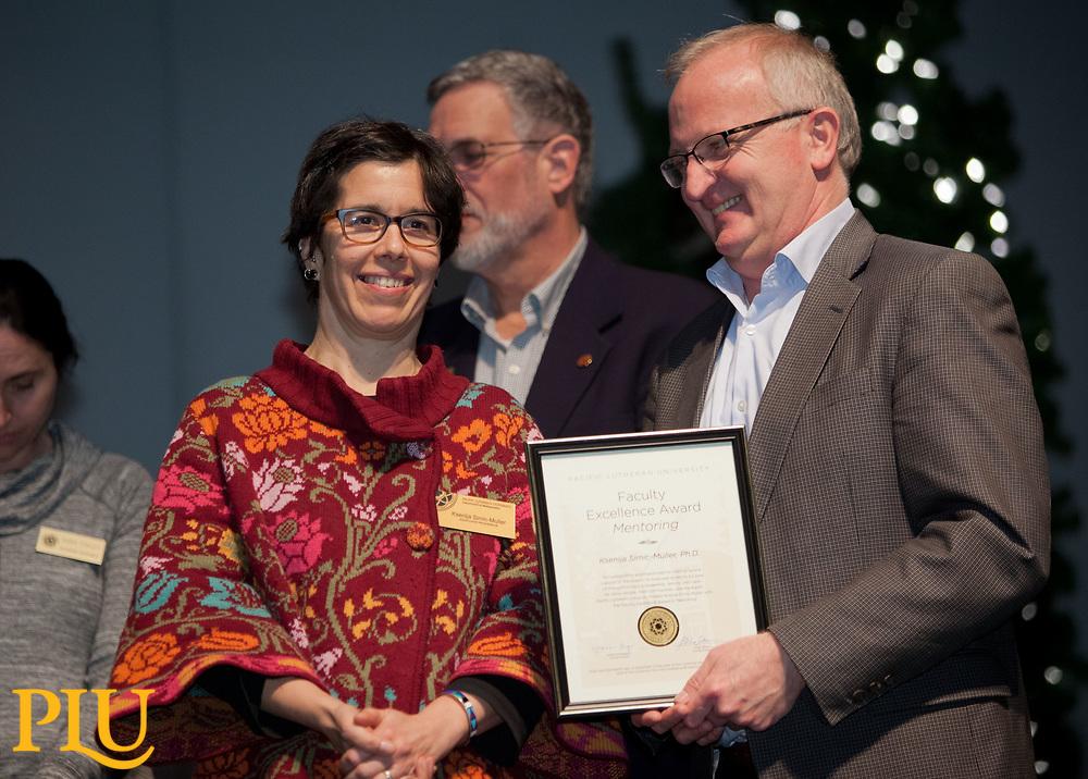 Allan Belton present an award to Ksenija Simic-Muller at the PLU Christmas Brunch, Thursday, Dec. 14, 2017. (Photo: John Froschauer/PLU)