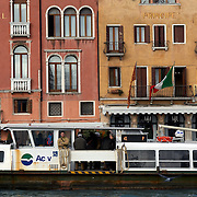 Italy, Veneto, Venice. November/12/2007...A public ferry moves along the Grand Canal, just in front of the Hotel Principe in Venice, Italy.