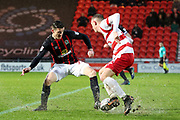 Blackburn Rovers midfielder Darragh Lenihan (26) makes a tackle on Doncaster Rovers forward Alfie Beestin (22) during the EFL Sky Bet League 1 match between Doncaster Rovers and Blackburn Rovers at the Keepmoat Stadium, Doncaster, England on 24 April 2018. Picture by Mick Atkins.