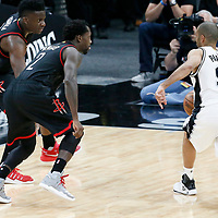 03 May 2017: San Antonio Spurs guard Tony Parker (9) passes the ball past Houston Rockets guard Patrick Beverley (2) and Houston Rockets center Clint Capela (15) during the San Antonio Spurs 121-96 victory over the Houston Rockets, in game 2 of the Western Conference Semi Finals, at the AT&T Center, San Antonio, Texas, USA.