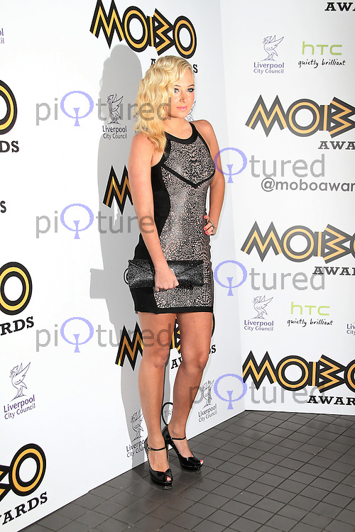 LONDON - SEPTEMBER 17: Tulisa Contostavlos attended the Nominations Launch of the MOBO Awards at Floridita London, UK. September 17, 2012. (Photo by Richard Goldschmidt)
