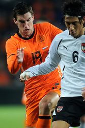 09-02-2011 VOETBAL: NEDERLAND - OOSTENRIJK: EINDHOVEN<br /> Netherlands in a friendly match with Austria won 3-1 / Kevin Strootman NED and Yasin Pehlivan<br /> ©2011-WWW.FOTOHOOGENDOORN.NL