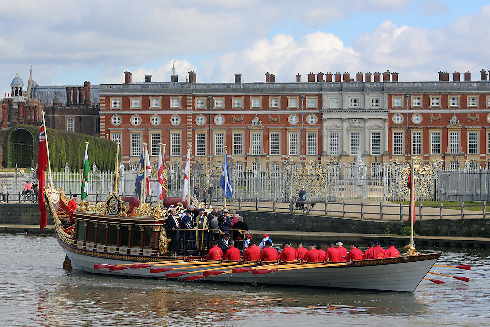 © Licensed to London News Pictures. 17/04/2016. Gloriana seen at Hampton Court Palace. The Queen's Row Barge Gloriana has undertaken its first engagement of 2016 with the Tudor Pull from Hampton Court Palace to the Tower of London. The popular vessel was accompanies by a small flotilla of traditional Thames cutters for the re-enactment of the ancient ritual. The Tudor Pull took place in glorious sunny weather on the Thames today. Credit: Rob Powell/LNP
