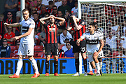 Penalty - Steve Cook (3) of AFC Bournemouth and Jack Simpson (25) of AFC Bournemouth look dejected after Aleksandar Mitrovic (9) of Fulham was fouled and a penalty awarded during the Premier League match between Bournemouth and Fulham at the Vitality Stadium, Bournemouth, England on 20 April 2019.