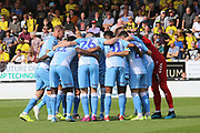 Coventry City players huge before kick off during the EFL Sky Bet League 1 match between Burton Albion and Coventry City at the Pirelli Stadium, Burton upon Trent, England on 14 September 2019.