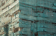 Tattered high rise scaffolding, Hanoi, Vietnam
