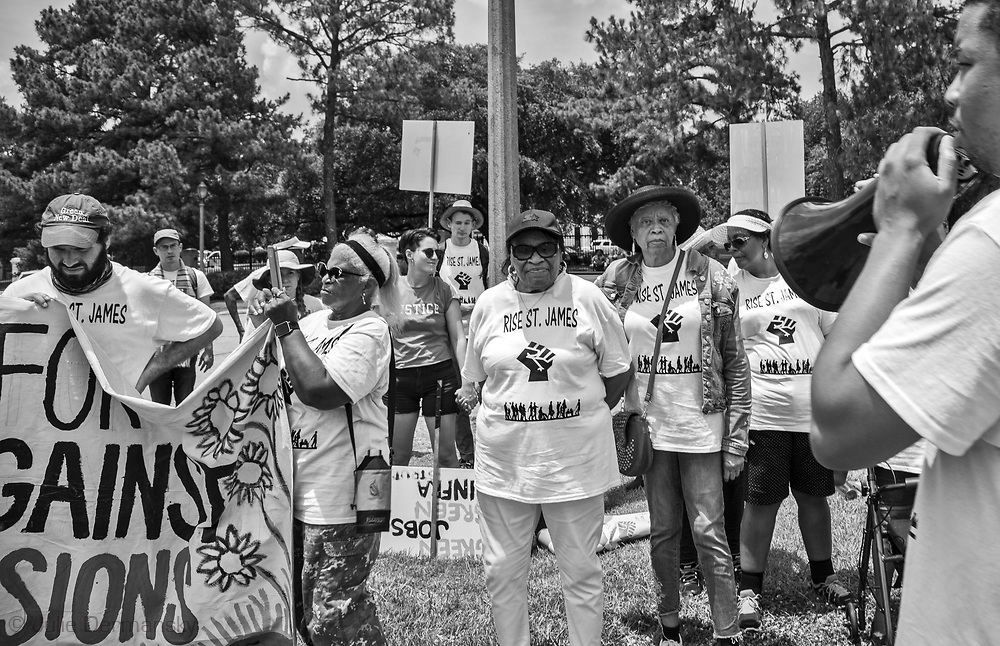 "Members of the Coalition against Death Alley and supporters  protest in front of the Governors Mansion in Baton Rouge Louisiana on the third day of a five day march through Louisiana's 'Cancer Alley' held by the Coalition Against Death Alley after being denied permits to march over river crossings. The Coalition Against Death Alley (CADA), is a group of Louisiana-based residents and members of various local and state organizations, is calling for a stop to the construction of new petrochemical plants and the passing of stricter regulations on existing industry in the area that include the groups RISE St. James, Justice and Beyond, the Louisiana Bucket Brigade, 350 New Orleans, and the Concerned Citizens of St. John  Louisiana's Cancer Alley, an 80-mile stretch along the Mississippi River, is also known as the ""Petrochemical Corridor,"" where there are over 100 petrochemical plants and refineries ."