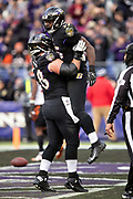 Baltimore Ravens rookie running back Gus Edwards (35) gets a lift in the air by Baltimore Ravens center Matt Skura (68) as they celebrate after Edwards runs for a third quarter touchdown that ties the score at 21-21 during the NFL week 11 regular season football game against the Cincinnati Bengals on Sunday, Nov. 18, 2018 in Baltimore. The Ravens won the game 24-21. (©Paul Anthony Spinelli)