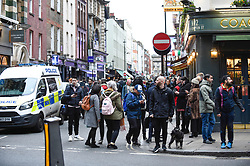 © Licensed to London News Pictures. 03/02/2020. LONDON, UK.  Old Compton Street is evacuated.  Scenes in Soho where the public are being evacuated by police and emergency services are in attendance after reports of an unexploded WW2 bomb being discovered in the area.  A wide cordon is being established from Shaftesbury Avenue, Charing Cross Road and the streets around Old Comption Street.  Photo credit: Stephen Chung/LNP
