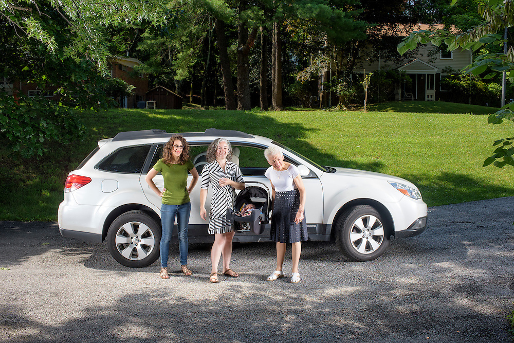 Pikesville, Maryland - June 25, 2015:  The Car Seat Ladies (L-R) Emily Levine, 34, Alisa Baer, 35, both from Manhattan, and Alisa's mother Deborah Baer, 67, from Pikesville, Maryland, hold Alisa's 7 week-old niece Leora Aghion in a Nuna Pipa infant car seat, ($300) at her sister's house in Pikesville, Maryland Thursday June 25th, 2015. <br />