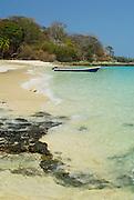 Outboard motorboat at the beach in Viveros island. Las Perlas Archipelago, Panama province, Panama, Central America.