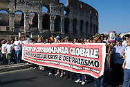 Roma 30 Maggio 2009.Manifestazione  dei No Global  per protestare contro il G8 e le politiche sull'immigrazione del Governo Berlusconi..Demonstrators march through the street of Rome to protest against a meeting of the Group of Eight (G8) interior and justice ministers taking place in the Italian capital.Banner. ' Rights of the global citizenship against the G8 of crisis and racism'.