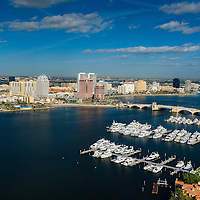 Aerial view of Palm Beach and West Palm Beach showing Intercoastal waterfront, marina, yachts and west Plam beach downtown business district.