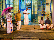 04 OCTOBER 2014 - GEORGE TOWN, PENANG, MALAYSIA: Hindu men wait for a procession honoring Durga to arrive at their temple in George Town during the Navratri procession. Navratri is a festival dedicated to the worship of the Hindu deity Durga, the most popular incarnation of Devi and one of the main forms of the Goddess Shakti in the Hindu pantheon. The word Navaratri means 'nine nights' in Sanskrit, nava meaning nine and ratri meaning nights. During these nine nights and ten days, nine forms of Shakti/Devi are worshiped.   PHOTO BY JACK KURTZ