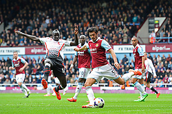 West Ham's defender James Tomkins clears the ball as Liverpool's defender Mamadou Sakho attempts to block   - Photo mandatory by-line: Mitch Gunn/JMP - Tel: Mobile: 07966 386802 06/04/2014 - SPORT - FOOTBALL - Boleyn Ground - London - West Ham United V Liverpool - Barclays Premier League