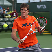March 1, 2014, Palm Springs, California: <br /> ATP player Dusan Lajovic demonstrates volley technique during Kids Day at the Indian Wells Tennis Garden sponsored by the Coachella Valley National Junior Tennis and Learning Network.<br /> (Photo by Billie Weiss/BNP Paribas Open)