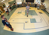 Jacob and Ethan program their droid to maneuver through the first phase of the maze during Let Go Your Mind summer camp through Gilford Parks and Recreation at the Gilford Middle School on Wednesday.   (Karen Bobotas/for the Laconia Daily Sun)