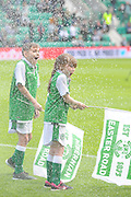 Spinkler system catches out flag bearers before the Ladbrokes Scottish Premiership match between Hibernian and Rangers at Easter Road, Edinburgh, Scotland on 13 May 2018. Picture by Kevin Murray.