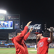 NEW YORK, NEW YORK - July 09: Daniel Murphy #20 of the Washington Nationals celebrates his two run home run in the seventh inning on his return to the dugout during the Washington Nationals Vs New York Mets regular season MLB game at Citi Field on July 09, 2016 in New York City. (Photo by Tim Clayton/Corbis via Getty Images)