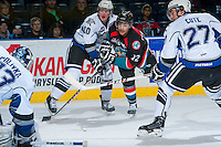 KELOWNA, CANADA - NOVEMBER 20:  Tyrell Goulbourne #12 of the Kelowna Rockets checks Ben Walker #10 0f the Victoria Royals on November 20, 2013 at Prospera Place in Kelowna, British Columbia, Canada.   (Photo by Marissa Baecker/Shoot the Breeze)  ***  Local Caption  ***