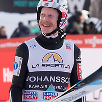 Raw Air photo from Vikersund Ski Flying Hill. Raw Air is a ten day ski jumping and ski flying tournament and is part of the World Cup competition. <br /> Raw Air 2018 was held in March 2018 in Norway at four different ski jumping hills - Oslo, Lillehammer, Trondheim and Vikersund. <br /> Vikersund Hill is a ski flying hill, in Modum, Norway is the largest in the world. Nine world records have been set on this hill, with the current one at 253.5 meters set by Stefan Kraft (Austria) on the 18th March 2017. Robert Johansson
