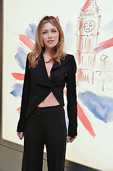 ABBEY CLANCY at the launch of the new Giusepe Zanotti store in Conduit Street, London on 26th October 2016.