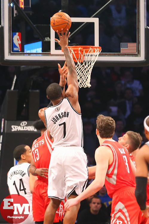 Apr 1, 2014; Brooklyn, NY, USA; Brooklyn Nets guard Joe Johnson (7) shoots the ball over Houston Rockets guard James Harden (13) during the first quarter at Barclays Center.