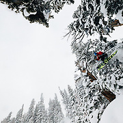 Tigger Knecht drops some air with blower powder in the backcountry near JHMR during a major winter storm in the Tetons.