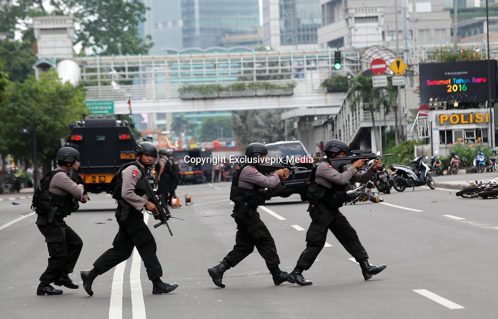 Jan. 14, 2016 - Jakarta, Jakarta, Indonesia -<br /> <br /> Indonesian police take position and aim their weapons as they pursue suspects after Jakarta blasts hit the Indonesia on January 14, 2016 in Jakarta, Indonesia. At least seven blasts were heard in Indonesia's capital Jakarata late Thursday morning leaving seven, including four attackers, dead. <br /> ©Exclusivepix Media