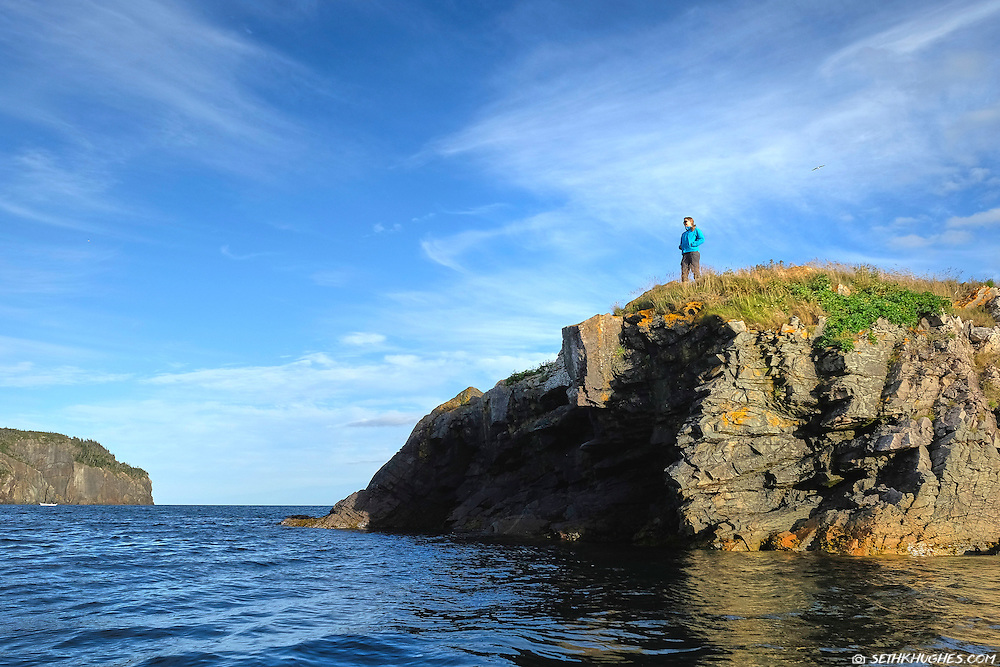A woman overlooks Trinity Bay in Newfoundland, Canada.