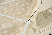 Nederland, Noord-Holland, Gemeente Schoorl, 04-20-2015; Camperduin, Hondsbossche en Pettemer Zeewering. De zeewering bij de kust van Callantsoog was een van de Zwakke Schakels in de kust, om de dijk te beschermen is er door middel van zandsuppletie een strand aangebracht voor de dijk. Detail van het opgespoten zand, het nieuwe strand, met aanplant van helm. Project Kust op kracht van het Hoogheemraadschap Hollands Noorderkwartier.<br /> Camperduin, Hondsbossch and Petten dam. The seawall is one of the weak links in the coast. To protect the dike, sand nourishment has been used to create a protecting beach.<br /> luchtfoto (toeslag op standard tarieven); aerial photo (additional fee required); copyright foto/photo Siebe Swart