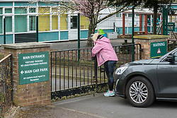 © Licensed to London News Pictures; 17/03/2020; Winterbourne, South Gloucestershire, UK. Coronavirus crisis 2020. Staff close the school gates at Elm Park Primary School in Nicholls Lane which is shut until next week for a deep clean after 50% of its teaching staff and 33% of its teaching assistants were forced to self-isolate after experiencing symptoms associated with coronavirus. The school has written to parents explaining that some staff had experienced high temperatures and a persistent cough and that the school could not obtain sufficient staff cover for classes. Photo credit: Simon Chapman/LNP.