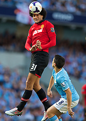 22.09.2013, Etihad Stadion, Manchester, ENG, Premier League, Manchester City vs Manchester United, 5. Runde, im Bild Manchester United's Marouane Fellaini in action against Manchester City during the English Premier League 5th round match between Manchester City and Manchester United at the Etihad Stadium, Manchester, Great Britain on 2013/09/22. EXPA Pictures © 2013, PhotoCredit: EXPA/ Propagandaphoto/ David Rawcliffe<br /> <br /> ***** ATTENTION - OUT OF ENG, GBR, UK *****