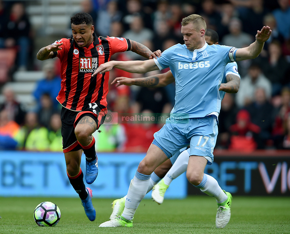 AFC Bournemouth's Joshua King (left) and Stoke City's Ryan Shawcross battle for the ball