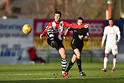 Lloyd James (4) of Exeter City plays a long ball up field during the EFL Sky Bet League 2 match between Exeter City and Accrington Stanley at St James' Park, Exeter, England on 25 November 2017. Photo by Graham Hunt.