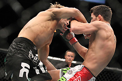 July 2, 2011; Dominick Cruz (white trunks) and Urijah Faber (black trunks) during their five round UFC Bantamweight Championship bout at the MGM Grand Garden Arena.