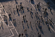 View from above of visitors walking through St. Mark's Plaza (Piazza San Marco), Venice, Italy...Subject photograph(s) are copyright Edward McCain. All rights are reserved except those specifically granted by Edward McCain in writing prior to publication...McCain Photography.211 S 4th Avenue.Tucson, AZ 85701-2103.(520) 623-1998.mobile: (520) 990-0999.fax: (520) 623-1190.http://www.mccainphoto.com.edward@mccainphoto.com.