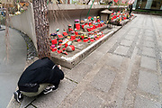 person photographing Jizo doll guardian deity of children at Rokkakudo temple Kyoto