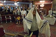 Tehran, Iran. September 13, 2007- Rosh Hashanah, Jewish New year. A man praying at the Pesyan Synagogue covers his head with a prayer shawl.