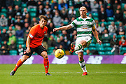 Celtic FC Midfielder Scott Brown plays the ball back during the Ladbrokes Scottish Premiership match between Celtic and Dundee United at Celtic Park, Glasgow, Scotland on 25 October 2015. Photo by Craig McAllister.