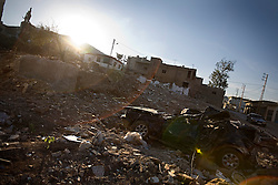 A flattened car sits in the afternoon sun near the spot where the Al-Akhrass family was killed in the war between Israel and Hezbollah, Aytaroun, Southern Lebanon, Oct. 23, 2006.