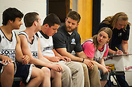Mount Mansfield head coach Joe O'Brien talks to the team on the bench during the unified basketball game between Colchester and Mount Mansfield at MMU High School on Monday afternoon April 25, 2016 in Jericho. (BRIAN JENKINS/for the FREE PRESS)