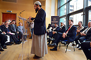 © Licensed to London News Pictures. 24/05/2013. London, UK Nick Clegg listens to The Iman of Ebrahim College, Sheikh Shams ad-Duha Muhammad. Nick Clegg, Liberal Democrat MP and Deputy Prime Minister, attends a multi faith gathering with the local multi faith community at the Hugh Cubitt Peabody Centre in Islington London today 24th May 2013. After meeting privately with political and faith leaders he and they made speeches in response to the attack and death of Drummer Lee Rigby in Woolwich, calling for the community to unite against the attack. Photo credit : Stephen Simpson/LNP