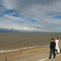Muslim family walking on the promenade,Sheerness, Isle of Sheppey, Kent