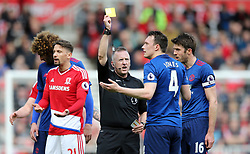 19.03.2017, Riverside Stadium, Middlesbrough, ENG, Premier League, FC Middlesbrough vs Manchester United, 29. Runde, im Bild Referee Jonathan Moss (c) issues a yellow card to Phil Jones (2nd r) of Manchester United // Referee Jonathan Moss (c) issues a yellow card to Phil Jones (2nd r) of Manchester United during the English Premier League 29th round match between FC Middlesbrough and Manchester United at the Riverside Stadium in Middlesbrough, Great Britain on 2017/03/19. EXPA Pictures © 2017, PhotoCredit: EXPA/ Focus Images/ Simon Moore<br /> <br /> *****ATTENTION - for AUT, GER, FRA, ITA, SUI, POL, CRO, SLO only*****