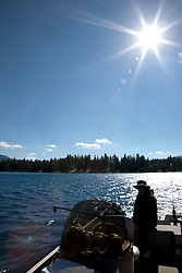 """Fishing on Lake Tahoe 3"" - This man was photographed fishing for Mackinaw near the West shore of Lake Tahoe, California."